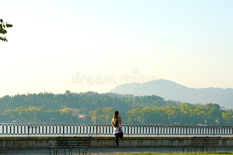Corfu, Greece, October 18 2018, A tourist stretches admiring the bay of Garitsa stock images