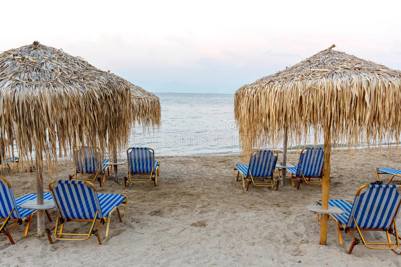 Corfu island beachside with chairs and umbrellas royalty free stock images