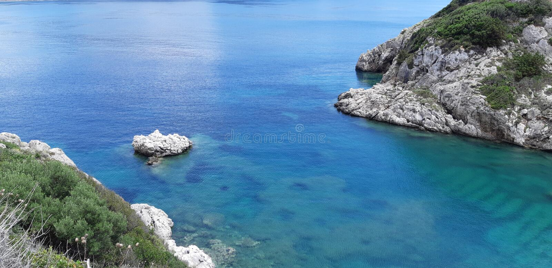 Corfu, Porto Timoni Afionas Beach. The best beaches in corfu, gardenos beach corfu, marathias beach, paradise beach corfu, corfu is known for Cape Drastis with royalty free stock photo