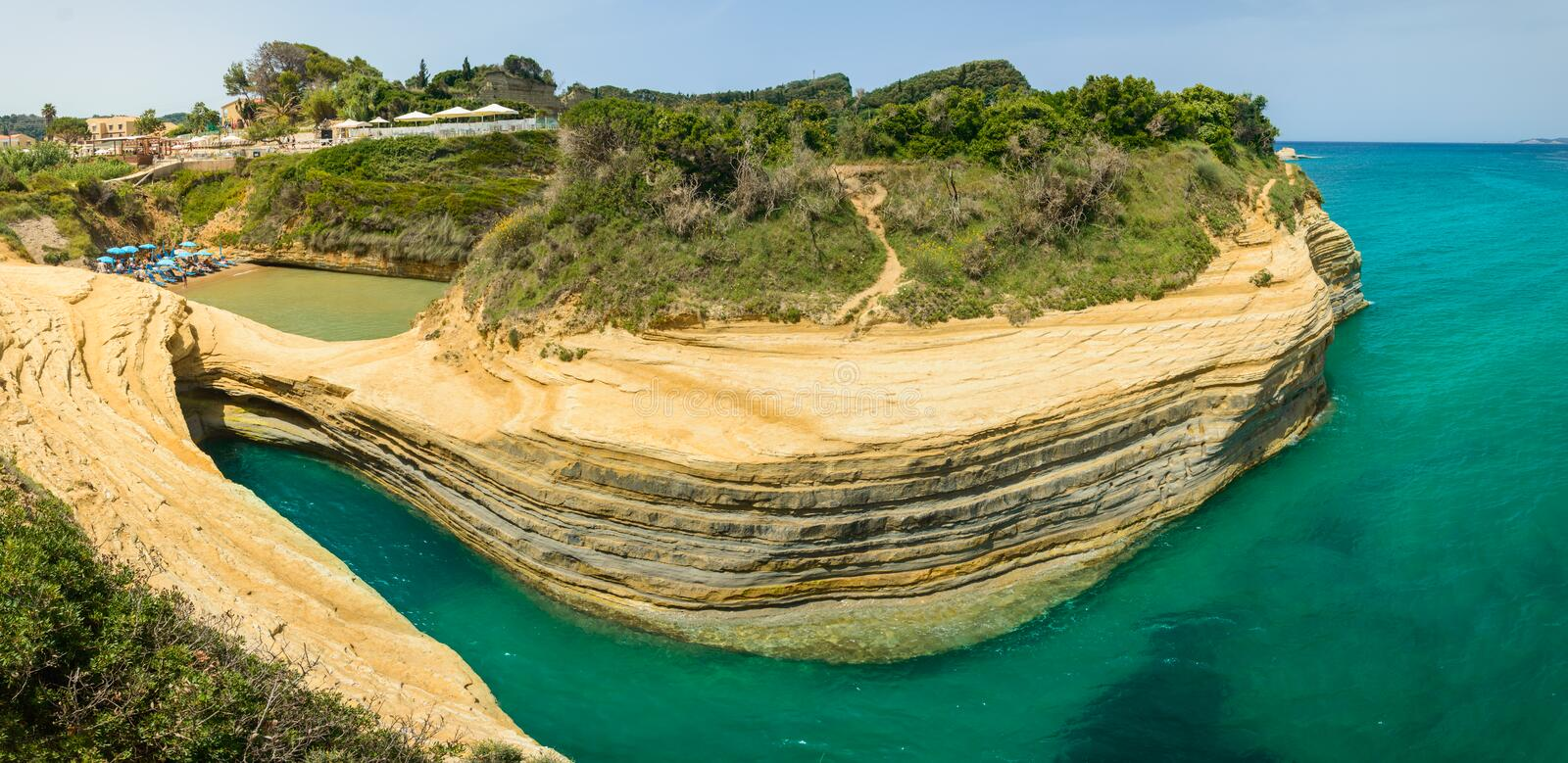 Corfu, Sidari Canal d'Amour panorama on the picturesque sandstone cliffs. Greece damour bay coast rocks beach formations sea waves trees forest sky clouds royalty free stock photos