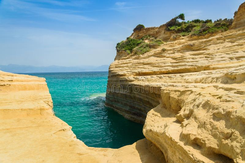 Corfu, Sidari Canal d'Amour panorama on the picturesque sandstone cliffs. Greece damour bay coast rocks beach formations sea waves trees forest sky clouds stock images