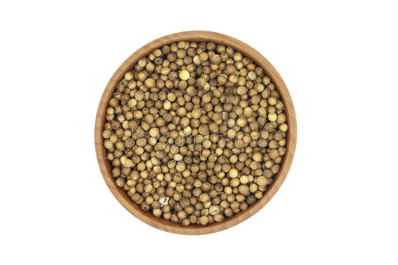 Coriander seeds in a wooden dish stock photo