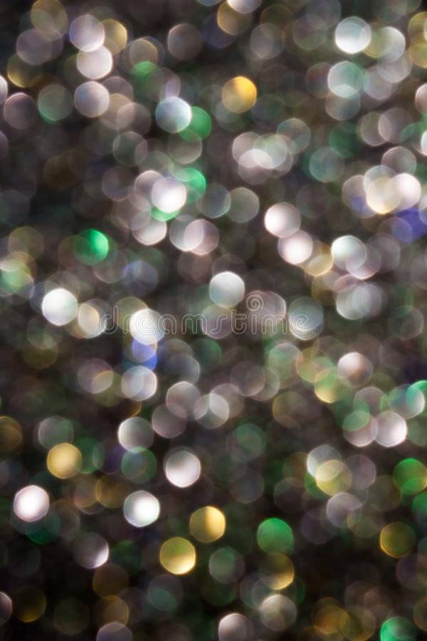 Coriandoli brillanti defocused multicolori fotografia stock libera da diritti