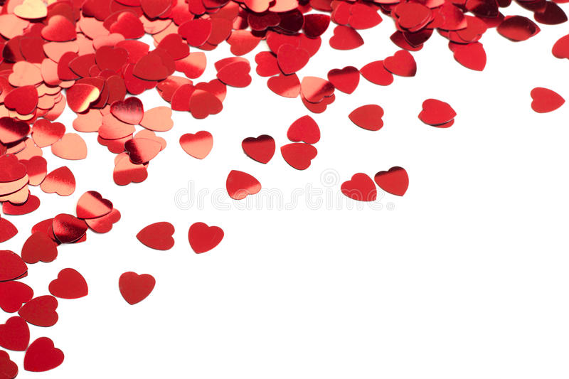 Coriandoli rossi del cuore fotografia stock libera da diritti