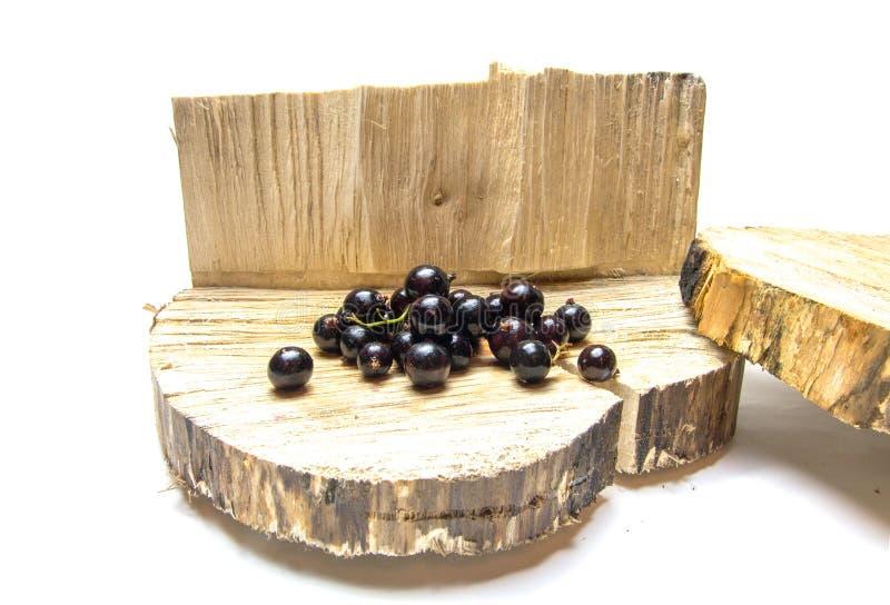 corinthe Groseilles sur le tronçon Un fond en bois image stock