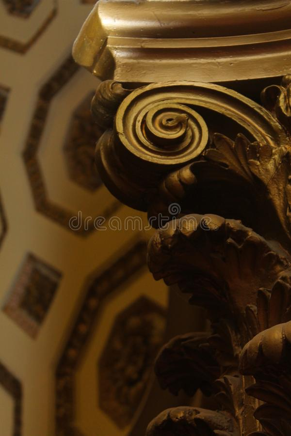 Corinthian Column detail in foreground with Roman coffer ceiling in background royalty free stock photography