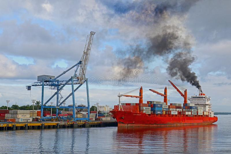 Corinto, Nicaragua- Oct 10, 2018. Freighter Spewing Black smoke pollution at a wharf. Coranto is a railroad terminus. And is Nicaragua`s largest and only royalty free stock image