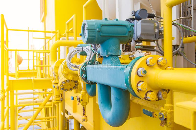 Coriolis flow meter or mass flow meter for measurement of oil and gas fluids in pipe line. This common used in oil and gas industry, Flow measurement high stock images
