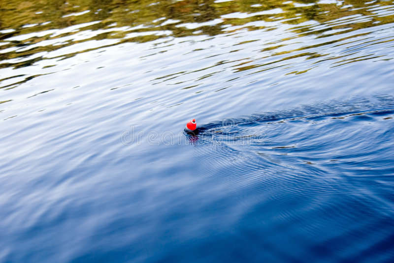 Cork being pulled in water royalty free stock photography