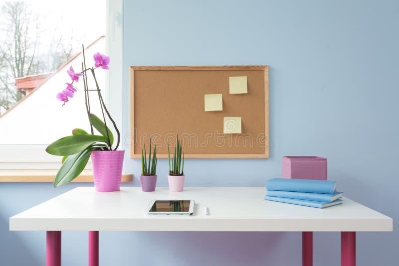Cork board above desk stock photos