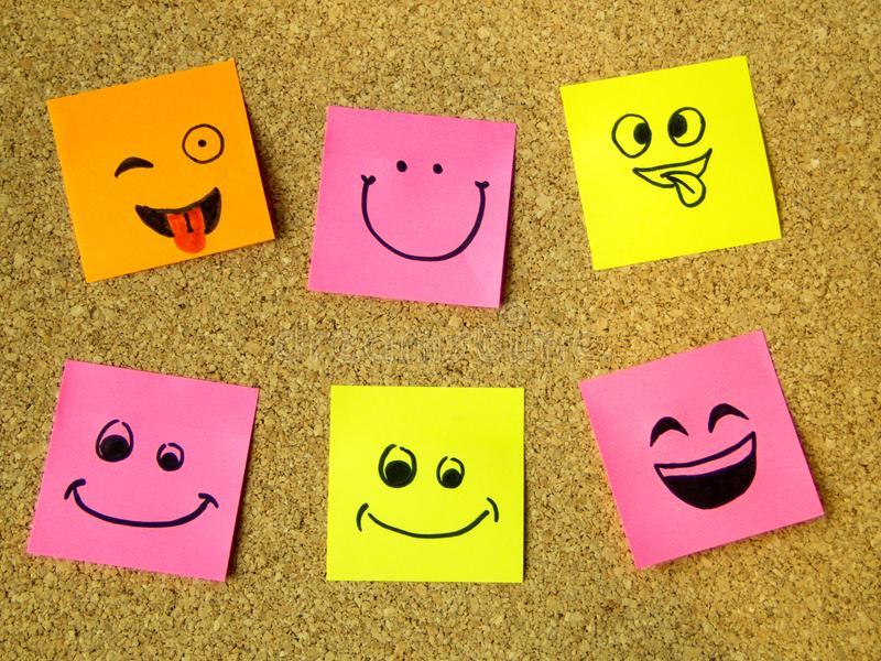 Cork board with colorful post its representing various emoticons with various emotions communication concept stock photos