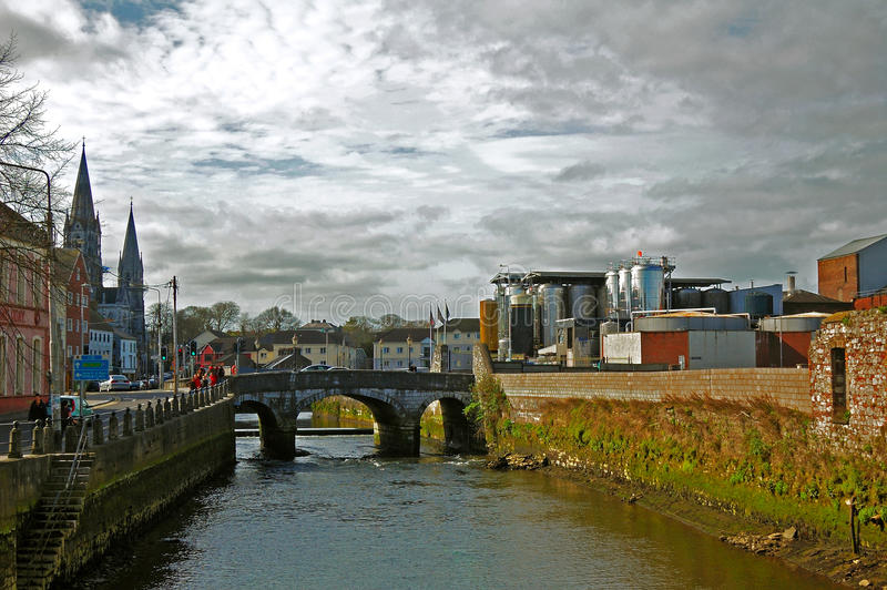 Cork City. Scenic view of Cork City, bridge, river and monument in background royalty free stock photo