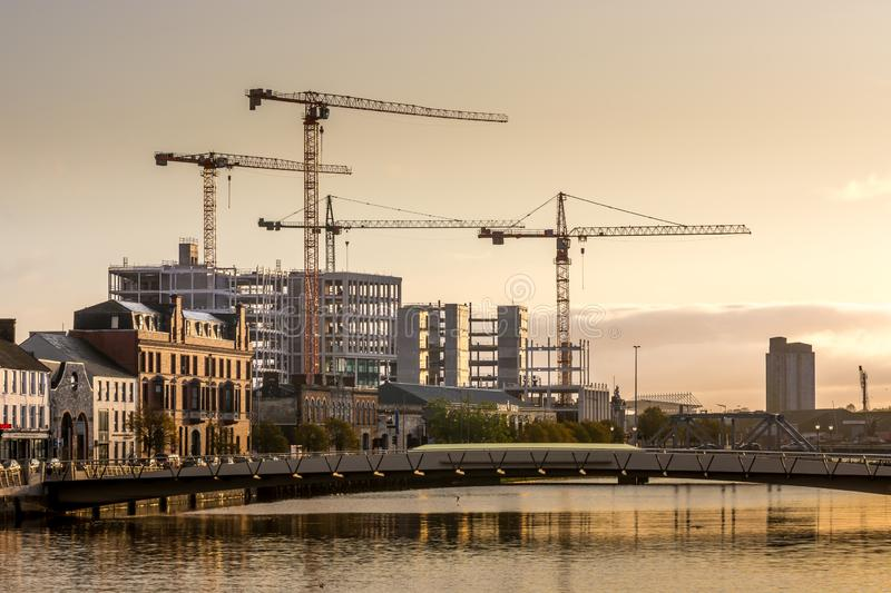 Cork Ireland industrial scenic view river Lee reflection crane building construction royalty free stock photo