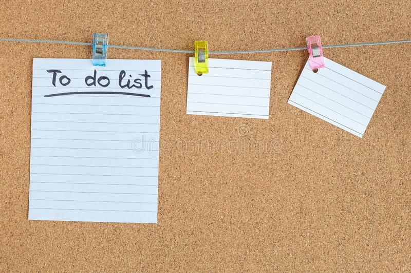 Cork memory board with blank peaces of paper hanging on rope with clothes pin, to do list, horizontal royalty free stock photography