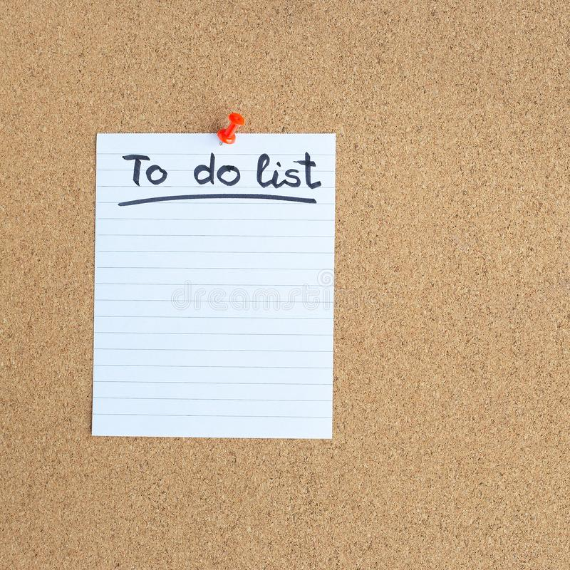 Cork memory board with blank piece of paper, to do list, bulletin board, square stock photo