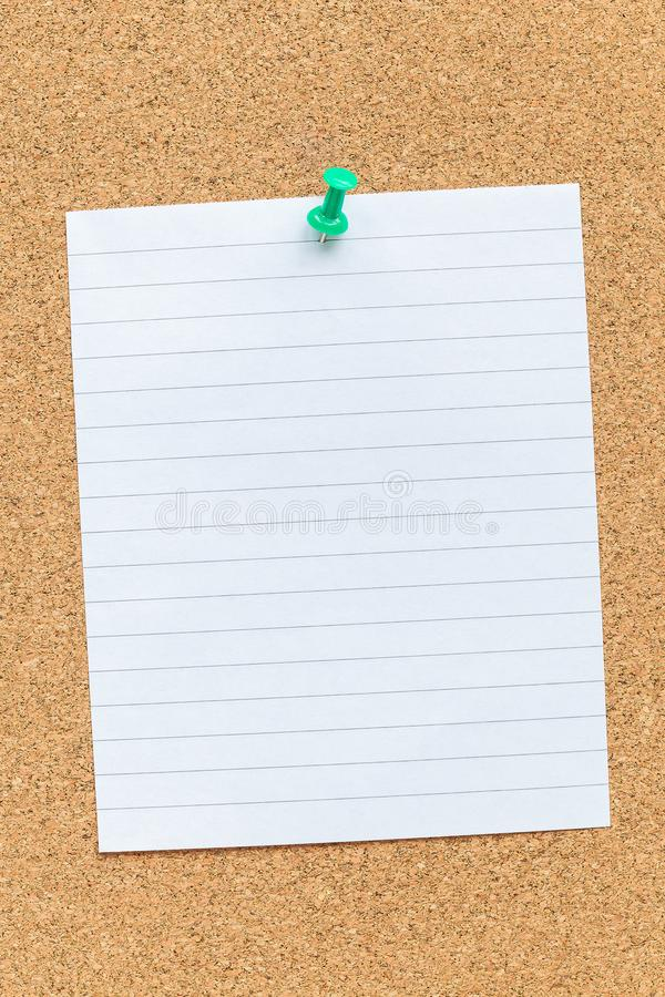 Cork memory board with pinned blank piece of paper, notes, bulletin board, horizontal stock photography
