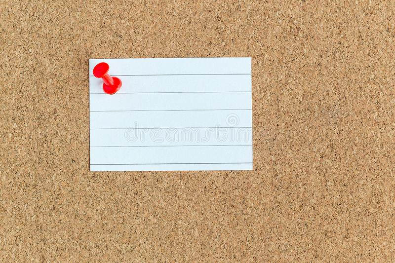 Cork memory board with pinned blank piece of paper notes, bulletin board, horizontal stock image