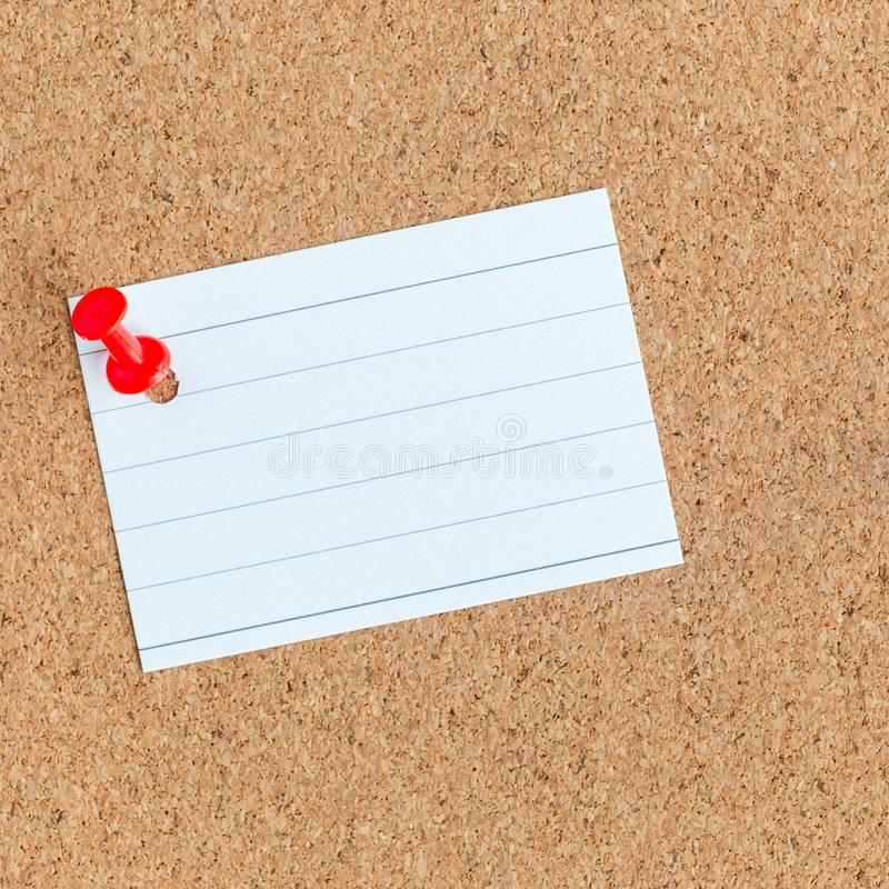 Cork memory board with pinned blank piece of paper, notes, bulletin board, square royalty free stock image
