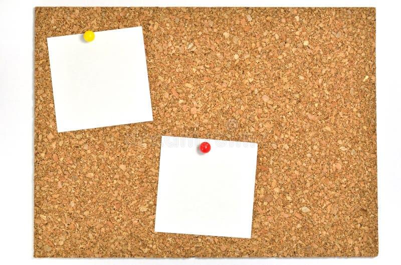 Cork raad en lege nota's. stock afbeeldingen