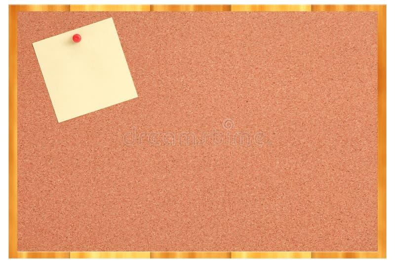 Cork raad met gele nota en rode speld stock fotografie