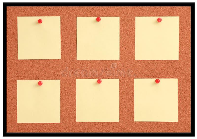 Cork raad met gele nota en rode speld stock afbeelding