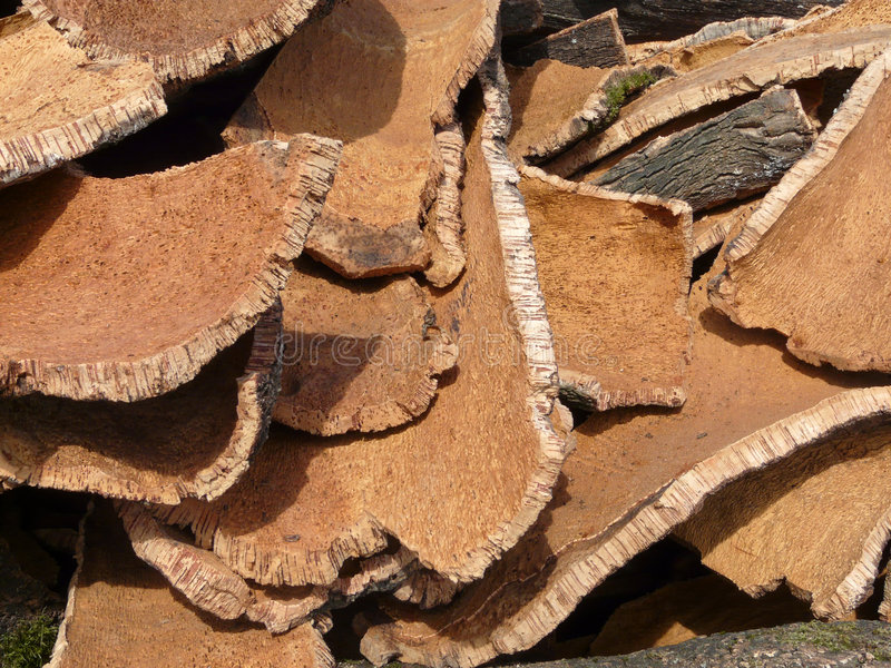 Cork's mountain. Stack of oak's bark used to produce corks for wine bottles stock image