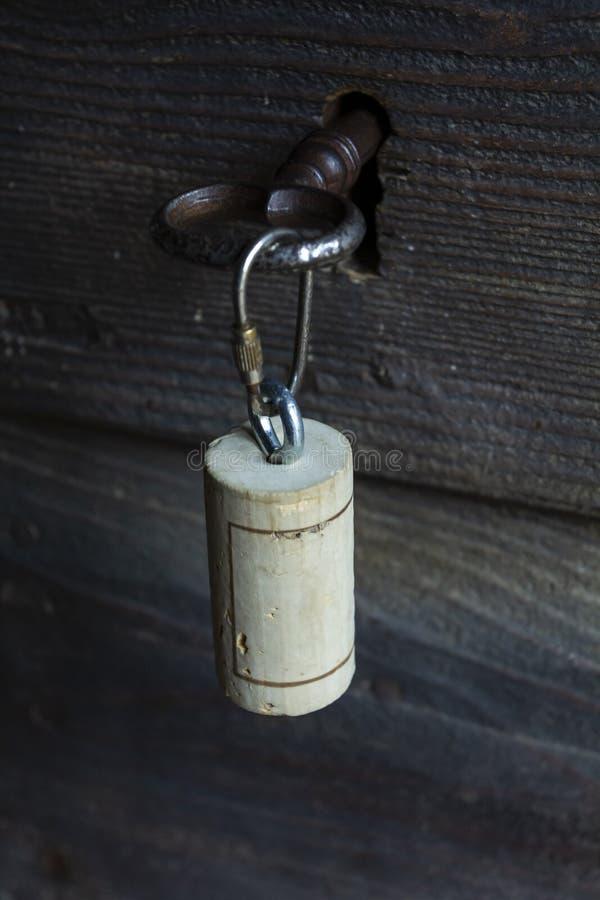 Cork stopper on the door. Corks at the door. Craftwork of cork. Italian key royalty free stock photos