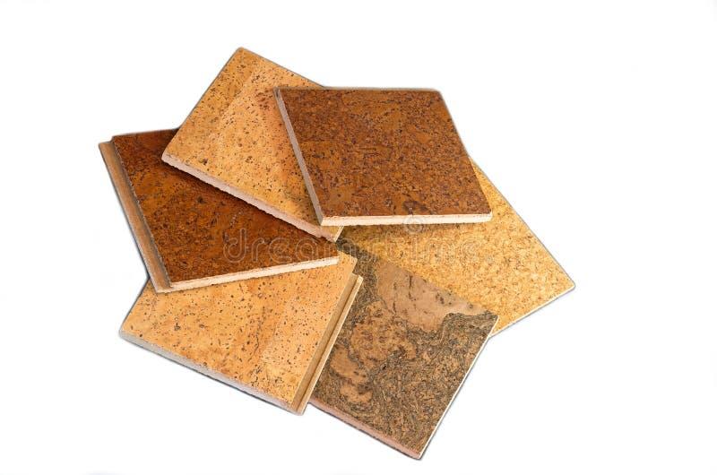 Cork Tiles Against White Background. Interlocking square cork floor tiles of different textures and species isolated against white background royalty free stock photos