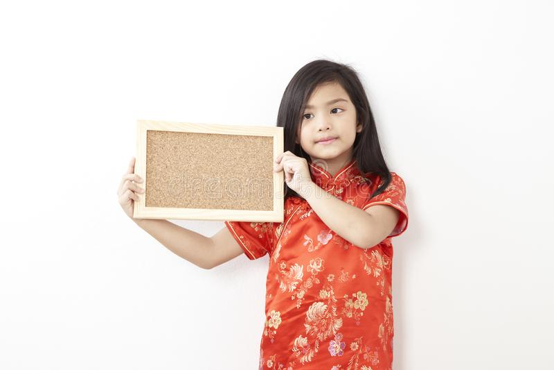 Cork van het meisjes Chinese nieuwe jaar raad royalty-vrije stock fotografie