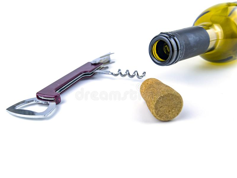 Cork from a wine bottle and a corkscrew on a white background royalty free stock image