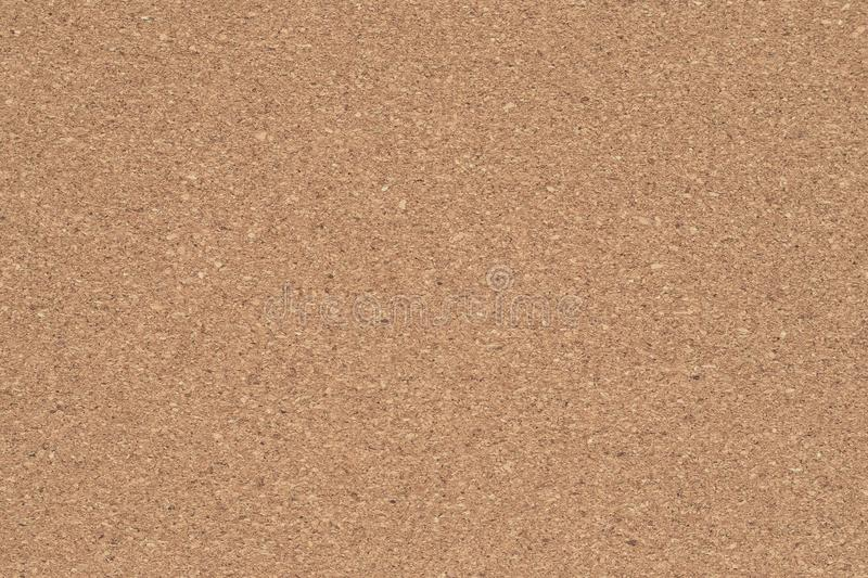 Corkboard background. Brown paper texture. Abstract pattern. Wood backdrop. Cardboard wall. Plywood. royalty free stock images