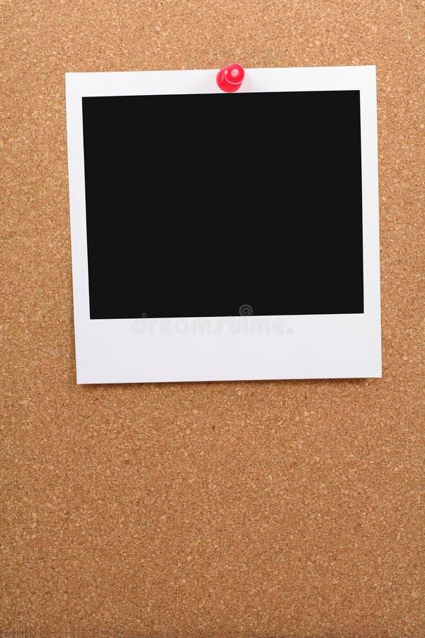 Corkboard y foto en blanco foto de archivo libre de regalías