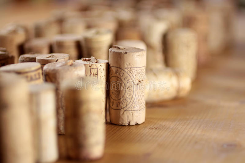 Corks Arranged On Wooden Desk Royalty Free Stock Images