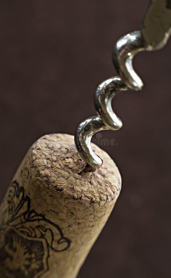 Corkscrew in bottle cork stock photos