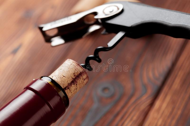Corkscrew and bottle of wine on the board - Image royalty free stock images
