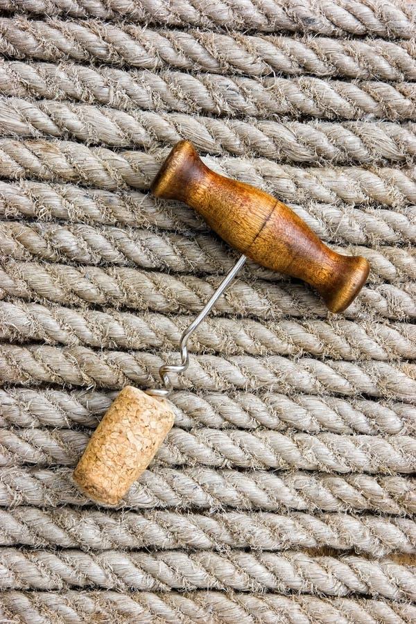 Corkscrew with a cork stock photos