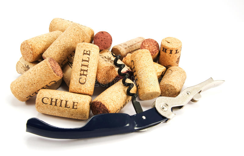 Corkscrew and several wine corks on white royalty free stock photos