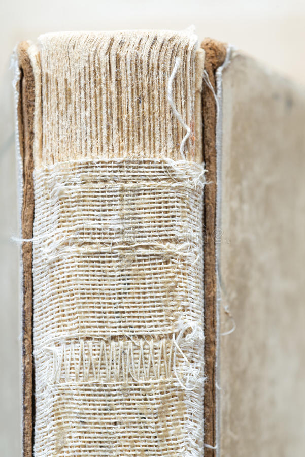 Ancient book. Ancient shabby book with binding threads open royalty free stock images