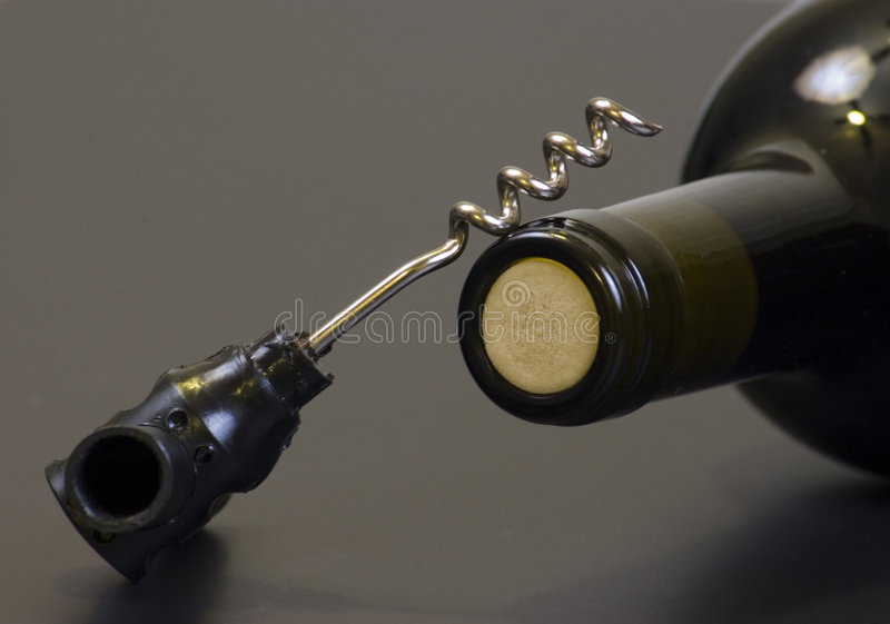 Corkscrew and wine bottle royalty free stock image