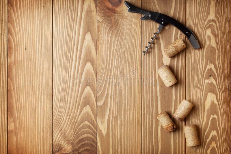 Corkscrew and wine corks stock image