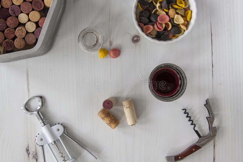 Corkscrews with corks, wine and pasta, overhead royalty free stock images