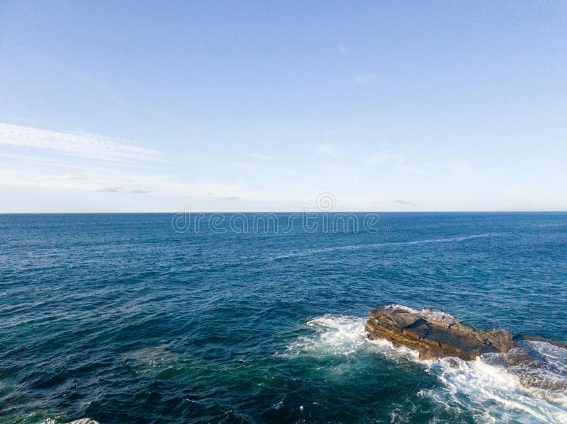 cormorant rock in the sea royalty free stock photography