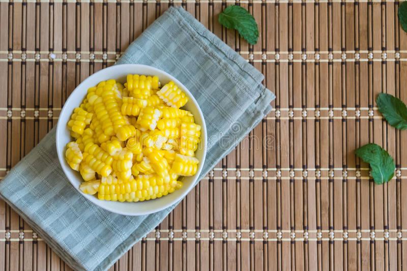 Corn Boil a cup of white bands on the bamboo floor. Corn Boil a cup of white bands on the bamboo floor stock images