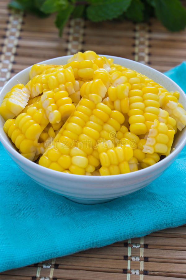 Corn Boil a cup of white bands on the bamboo floor. Corn Boil a cup of white bands on the bamboo floor stock photo