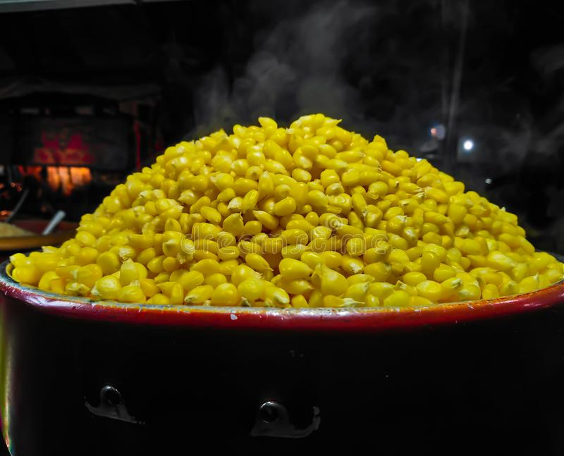 Corn boil hot, add sugar, milk, butter and delicious. Corn boil hot, add sugar, milk, butter and delicious in Market royalty free stock image
