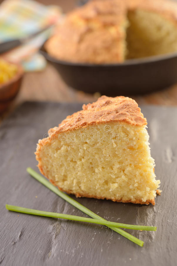 Corn bread. Just baked corn bread on a rustic table stock photo
