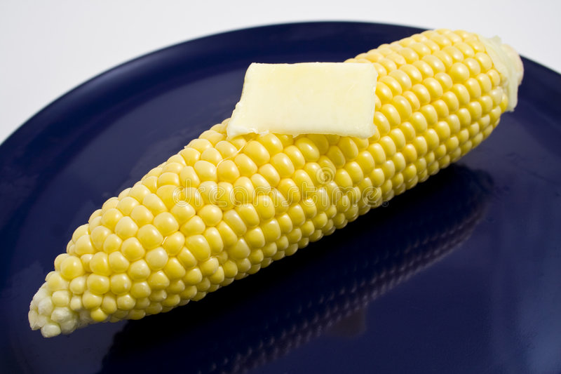Corn and butter on a plate stock photos
