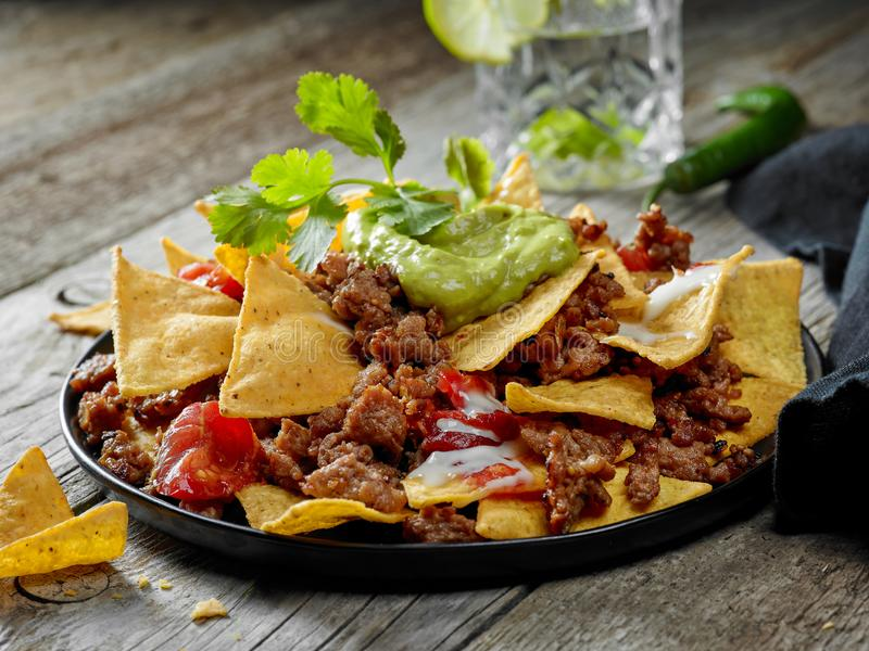 Corn chips nachos with fried minced meat royalty free stock images