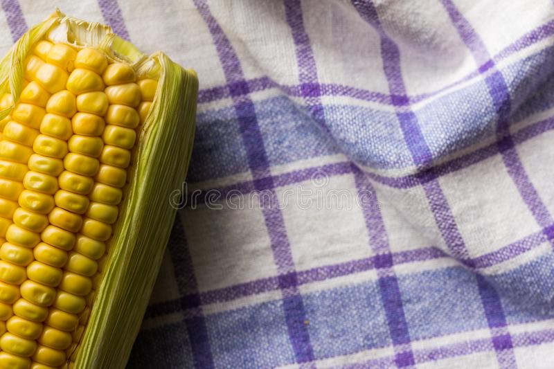 Corn Cob on bowl and rustic fabric. Food of Festa Junina, a typical brazilian party. stock photos