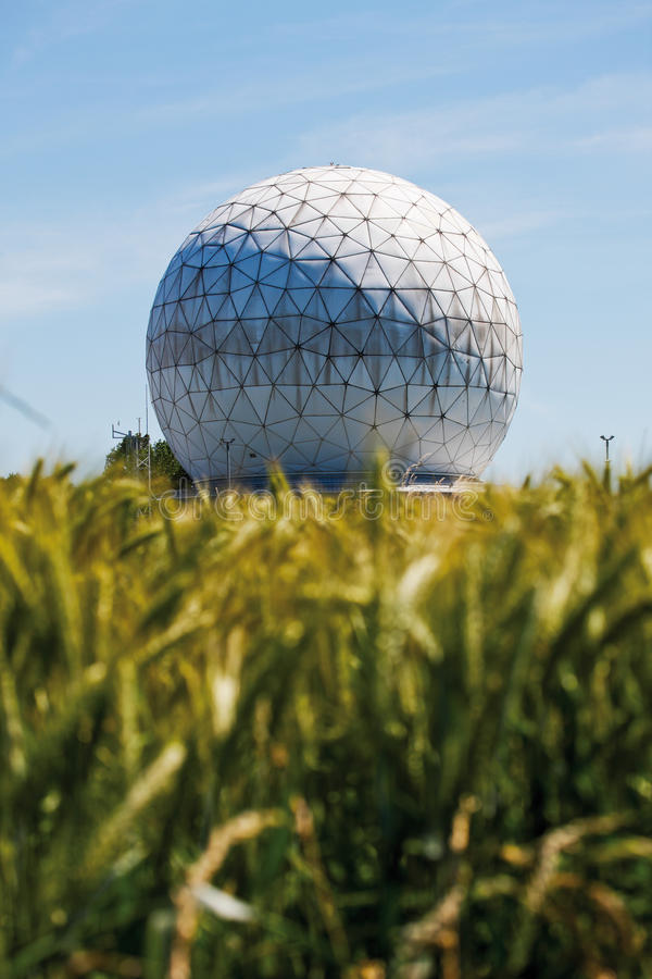 Corn field with radome in background. Grass and blue sky royalty free stock photography